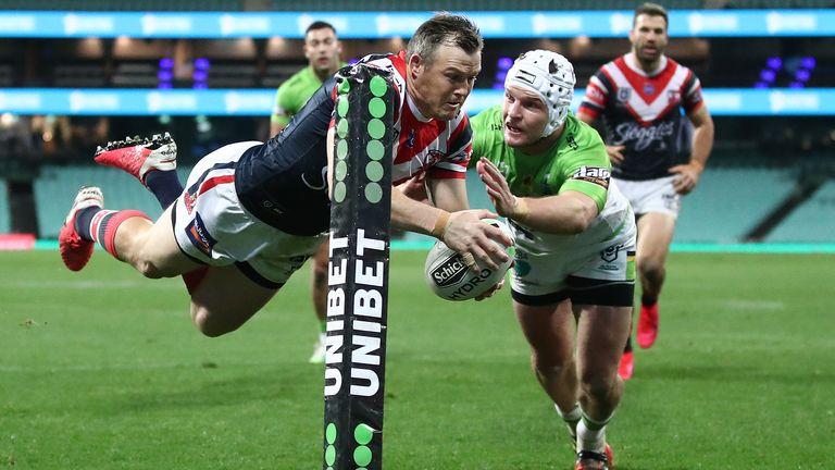 Brett Morris dives over to score for the Roosters