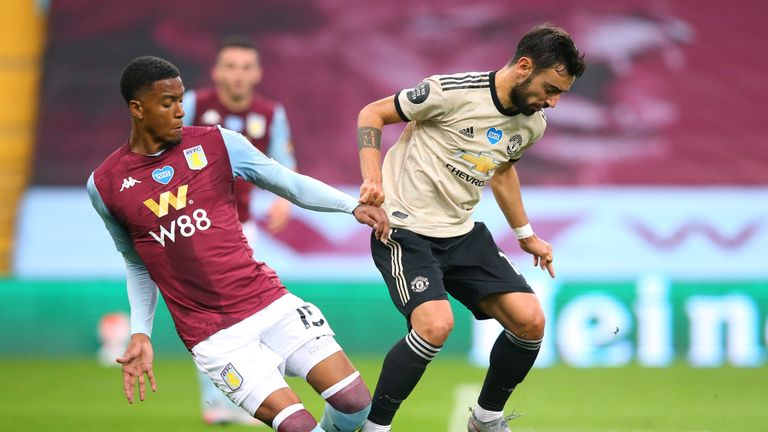 Bruno Fernandes of Manchester United is fouled by Ezri Konsa Ngoyo of Aston Villa to win a penalty kick during the Premier League match between Aston Villa and Manchester United at Villa Park on July 09, 2020 in Birmingham, England.