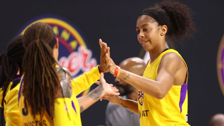 Candace Parker high-fives her Sparks' team-mate during their win over the Connecticut Sun