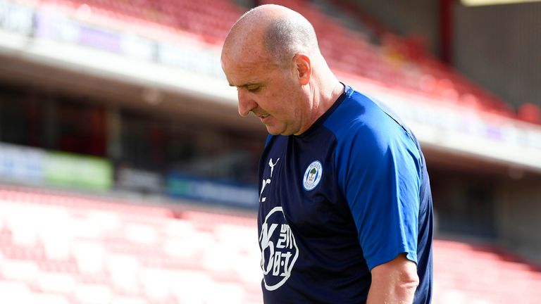 Paul Cook leaves Wigan after more than three years in charge