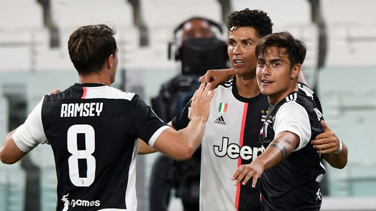 TURIN, ITALY - JULY 20: Cristiano Ronaldo of Juventus celebrates goal with teammates Paulo Dybala of Juventus (R) and Aaron Ramsey of Juventus (L) during the Serie A match between Juventus and SS Lazio at Allianz Stadium on July 20, 2020 in Turin, Italy. (Photo by Chris Ricco/Getty Images)