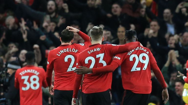 Manchester United players salute the crowd after winning the English Premier League football match between Manchester City and Manchester United at the Etihad Stadium in Manchester, north west England, on December 7, 2019.