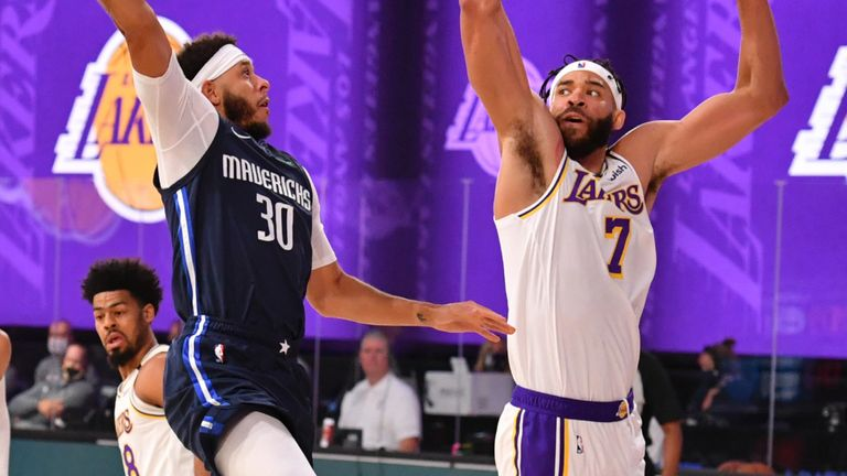 Seth Curry lofts a shot over Javale McGee