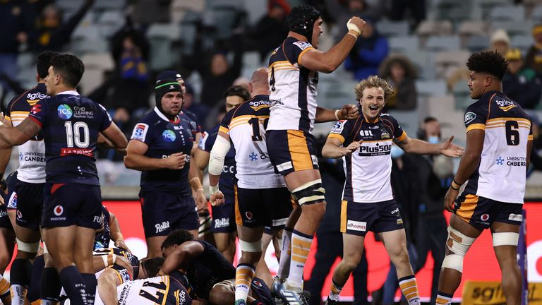 Darcy Swain celebrates after team mate Will Miller scores for the Brumbies