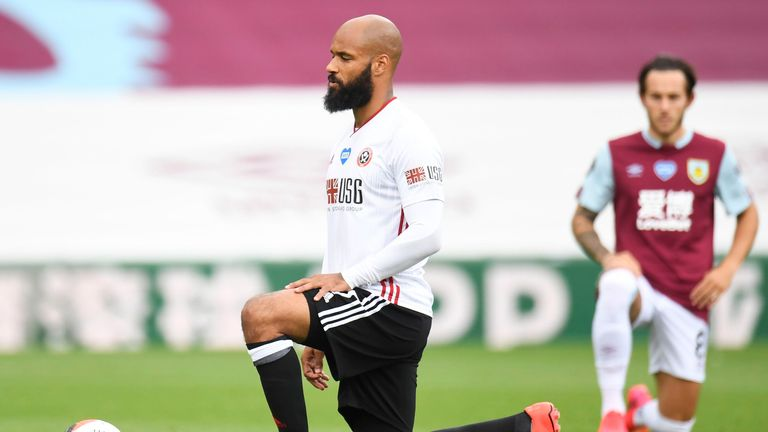 David McGoldrick takes the knee