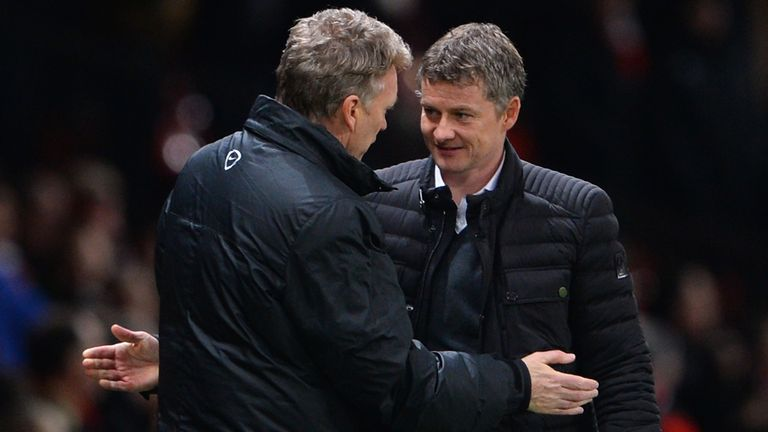 Cardiff City Manager Ole Gunnar Solskjaer congratulates Manchester United Manager David Moyes at the end of the Barclays Premier League match between Manchester United and Cardiff City at Old Trafford on January 28, 2014 in Manchester, England.