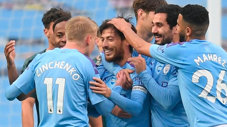 Manchester City's Spanish midfielder David Silva (C) celebrates scoring their fourth goal during the English Premier League football match between Manchester City and Newcastle United at the Etihad Stadium in Manchester, north west England, on July 8, 2020