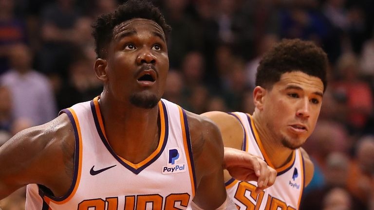 DeAndre Ayton and Devin Booker in action for Phoenix against Milwaukee