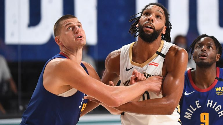 Nikola Jokic contests a rebound against the Pelicans