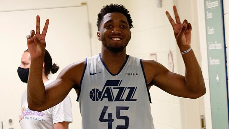 Donovan Mitchell salutes the cameras after the Utah Jazz held their first practice inside the Orlando bubble