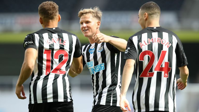 Dwight Gayle celebrates his early goal with teammates