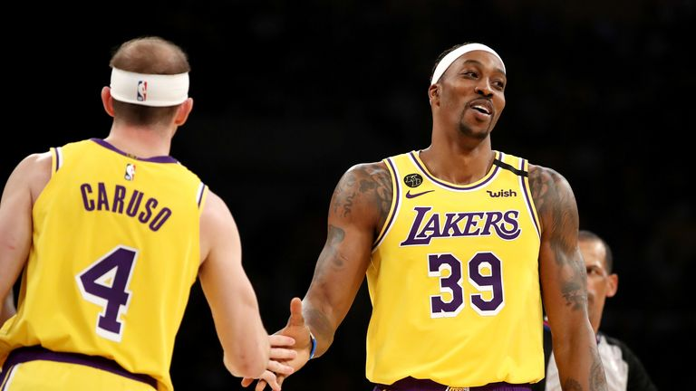 The Lakers hope Dwight Howard (right) will join up with the team when they fly out to Orlando