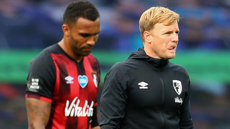 Eddie Howe and Calum Wilson look dejected following Bournemouth's relegation from the Premier League