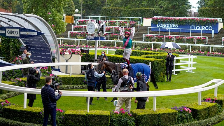 ASCOT, ENGLAND - JULY 25: Frankie Dettori leaps off in the winners enclosure after riding Enable to win her third The King George VI And Queen Elizabeth Qipco Stakes at Ascot Racecourse on July 25, 2020 in Ascot, England.