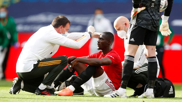 Eric Bailly of Manchester United is seen to by medical staff after a collision during the FA Cup Semi Final match between Manchester United and Chelsea at Wembley Stadium on July 19, 2020 in London, England. Football Stadiums around Europe remain empty due to the Coronavirus Pandemic as Government social distancing laws prohibit fans inside venues resulting in all fixtures being played behind closed doors.