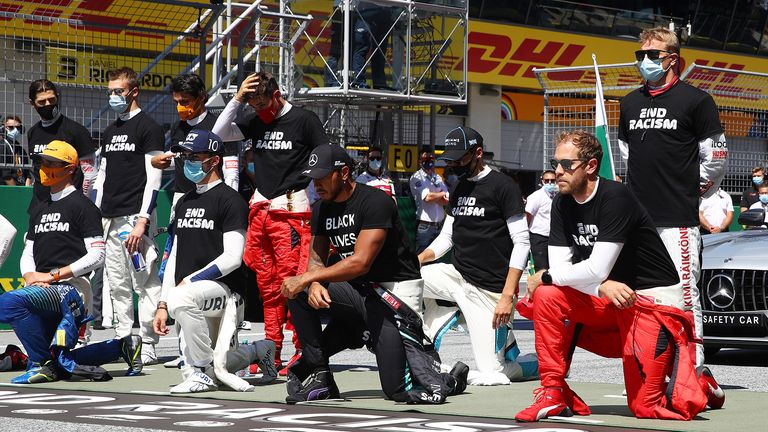 Lewis Hamilton of Great Britain and Mercedes GP and some of the F1 drivers take a knee on the grid in support of the Black Lives Matter movement ahead of the Formula One Grand Prix of Austria at Red Bull Ring on July 05, 2020 in Spielberg, Austria.
