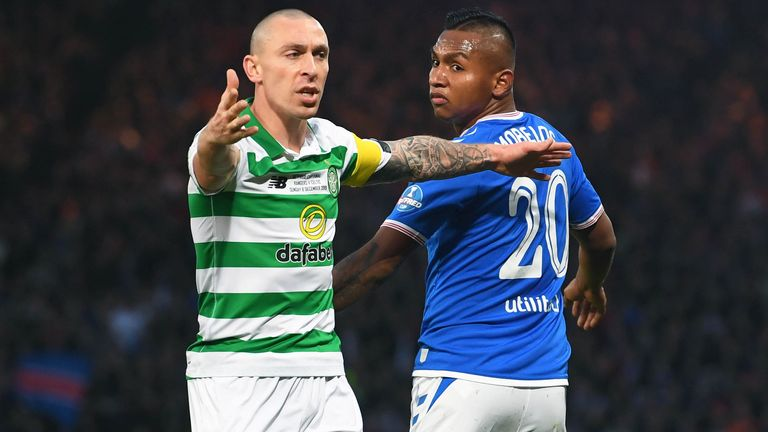 Scott Brown and Alfredo Morelos in action