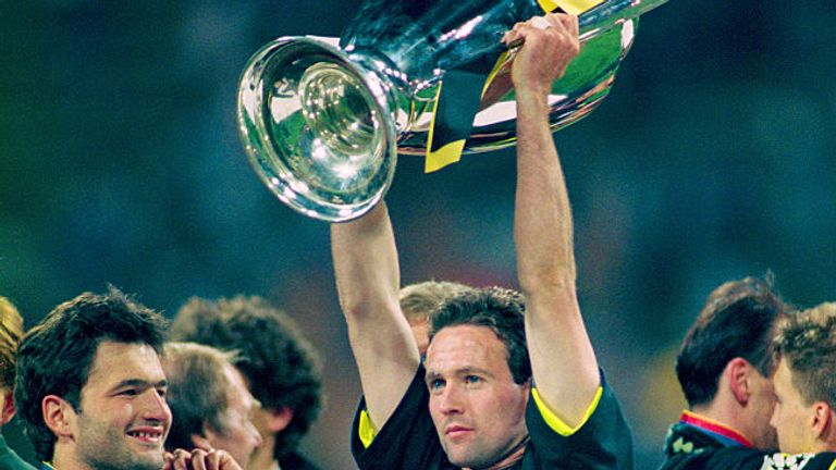 Lambert holds aloft the Champions League trophy after winning with Dortmund in 1997