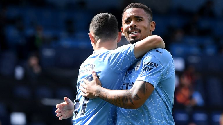 Gabriel Jesus celebrates with teammate Phil Foden after scoring the opening goal against Norwich