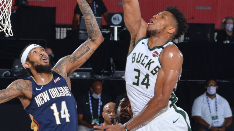 Giannis Antetokounmpo soars for a huge dunk against the New Orleans Pelicans
