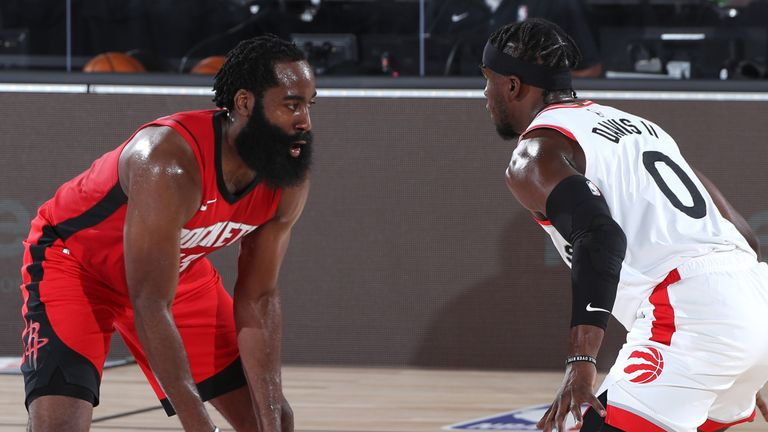 James Harden is guarded by Terence Davis