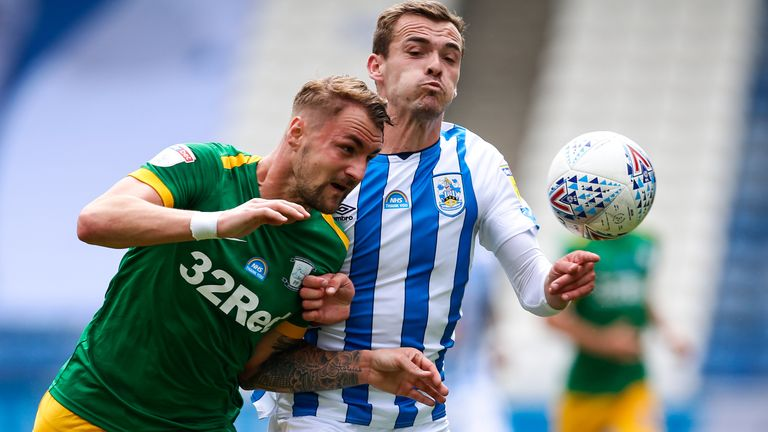 HUDDERSFIELD, ENGLAND - JULY 04: Patrick Bauer of Preston North End and Harry Toffolo of Huddersfield Town during the Sky Bet Championship match between Huddersfield Town and Preston North End at John Smith's Stadium on July 4, 2020 in Huddersfield, England. (Photo by Ben Early - AMA/Getty Images)