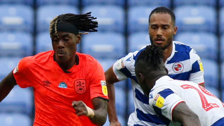 Huddersfield picked up a valuable point in their survival battle at Madejski Stadium