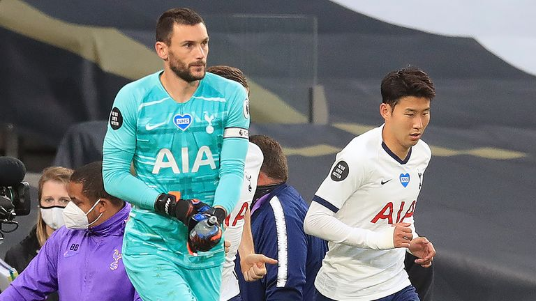 Tottenham Hotspur's French goalkeeper Hugo Lloris (L) and Tottenham Hotspur's South Korean striker Son Heung-Min arrive on the pitch for the second half during the English Premier League football match between Tottenham Hotspur and Everton at Tottenham Hotspur Stadium in London, on July 6, 2020