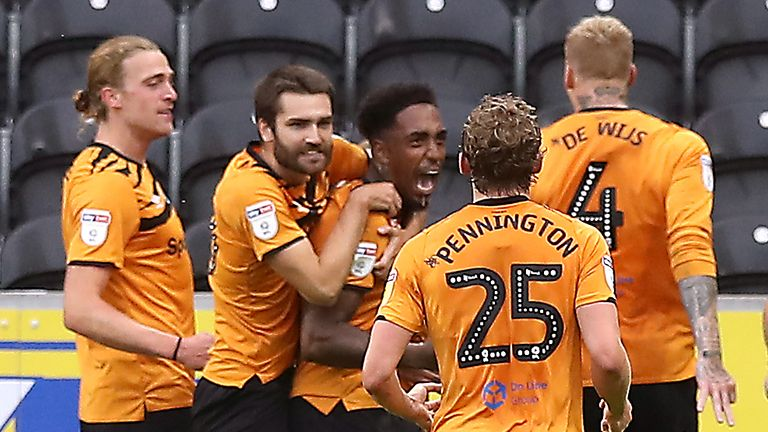 """Hull City's Mallik Wilks celebrates scoring his side's second goal of the game during the Sky Bet Championship match at the KCOM Stadium, Hull. PA Photo. Issue date: Thursday July 2, 2020. See PA story SOCCER Hull. Photo credit should read: Martin Rickett/PA Wire. RESTRICTIONS: EDITORIAL USE ONLY No use with unauthorised audio, video, data, fixture lists, club/league logos or """"live"""" services. Online in-match use limited to 120 images, no video emulation. No use in betting, games or single club/league/player publications."""