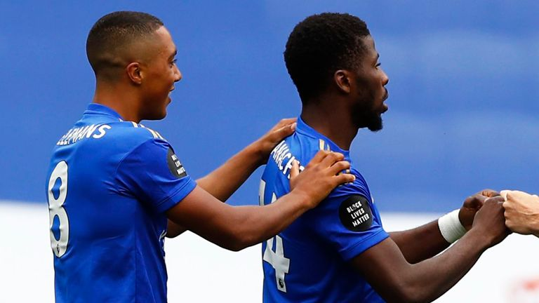 Kelechi Iheanacho is congratulated by Youri Tielemans (left) for opening the scoring against Crystal Palace