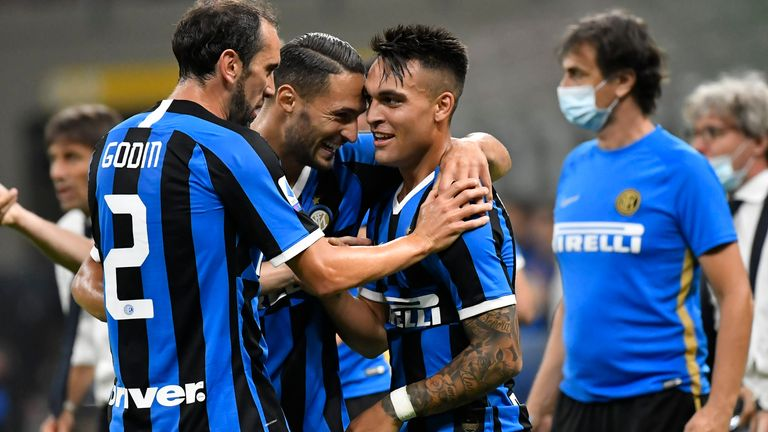 Martinez is congratulated by his Inter team-mates after scoring against Torino