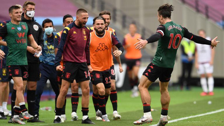 Jack Grealish celebrates with teammates after scoring for Villa at the London Stadium