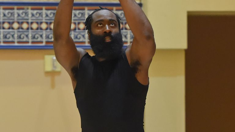 James Harden gets a shot up during his debut Rockets practice inside the NBA bubble
