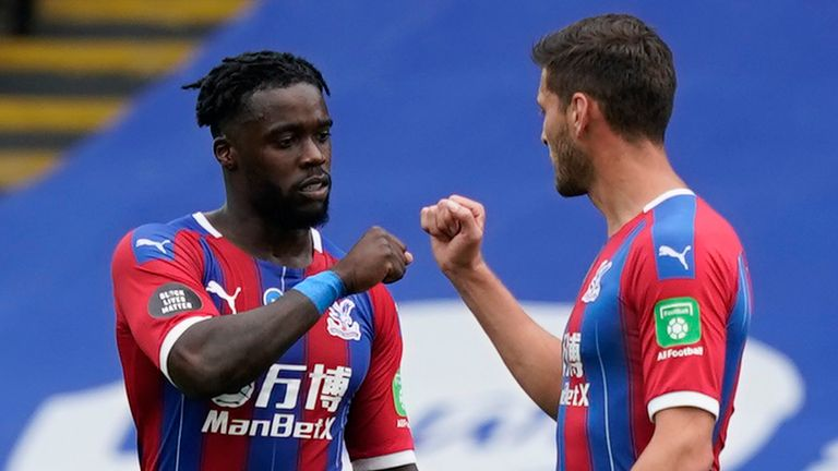 Jeffrey Schlupp fist bumps Joel Ward after scoring his equaliser