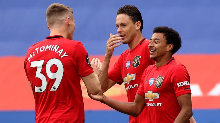 Jesse Lingard celebrates with teammates after doubling Man Utd's lead