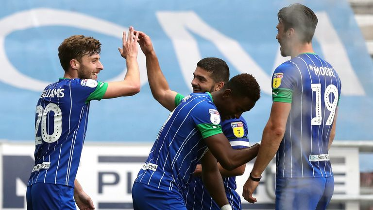 Joe Williams celebrates scoring Wigan's seventh after 45 minutes