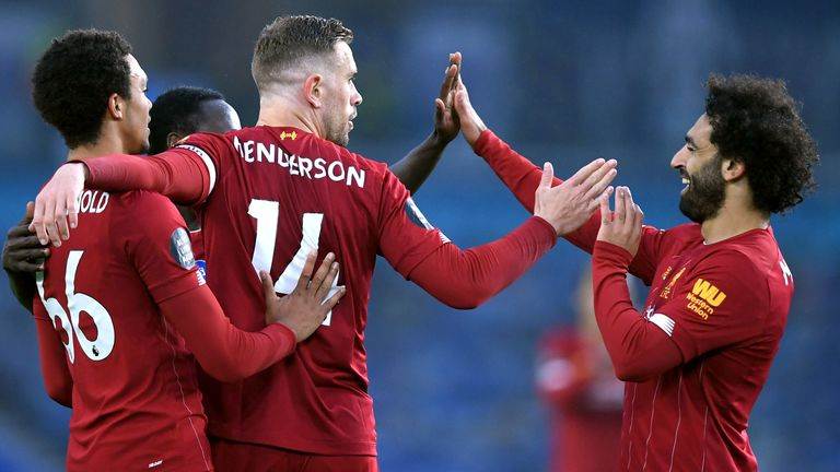 Jordan Henderson of Liverpool celebrates with his team after scoring his sides second goal during the Premier League match between Brighton & Hove Albion and Liverpool