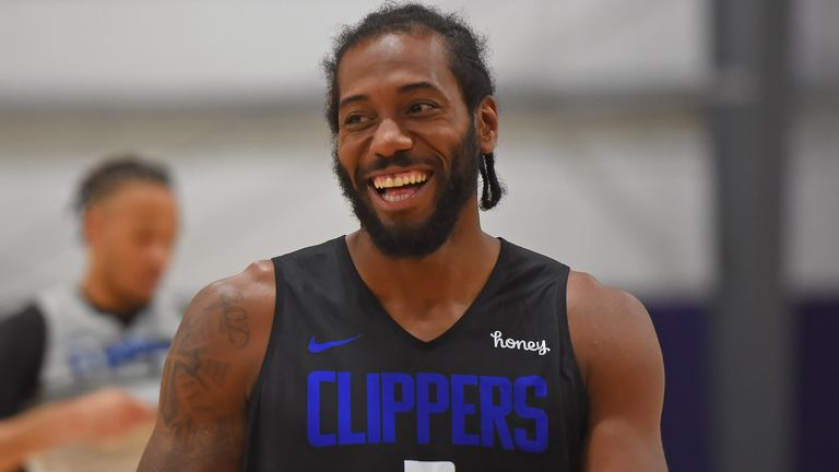 Kawhi Leonard smiles during an LA Clippers practice inside the NBA's Orlando bubble