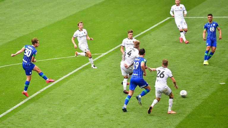 Kieran Dowell nets Wigan's third after 32 minutes