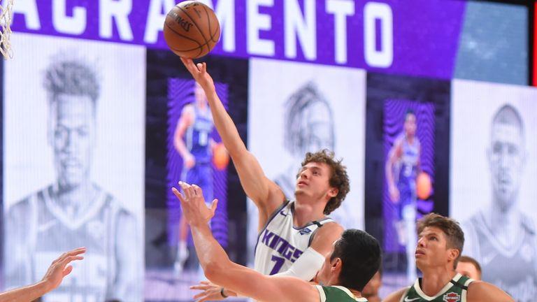 Kyle Guy of the Sacramento Kings shoots the ball against the Milwaukee Bucks