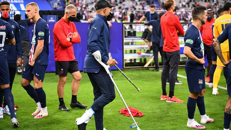 Kylian Mbappe joined his teammates on crutches following their French Cup final triumph