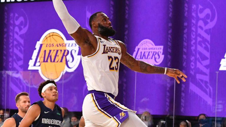 LeBron James soars for a breakaway slam against the Mavericks