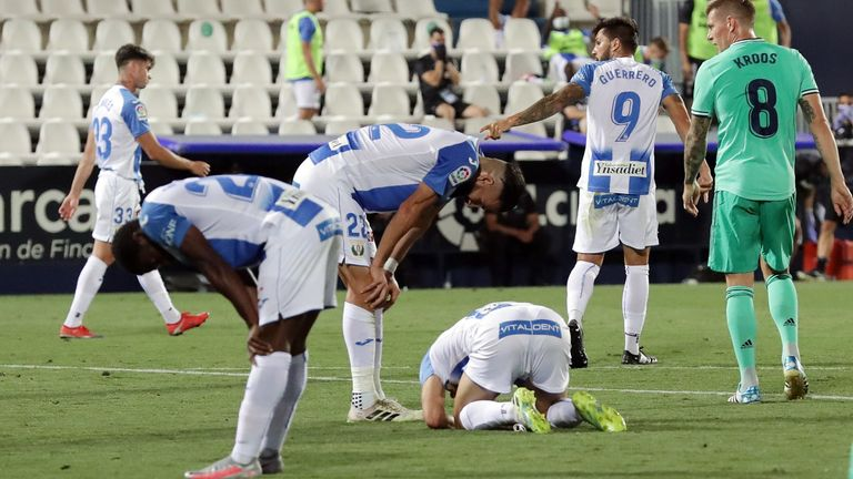 Leganes players look dejected as their side are relegated