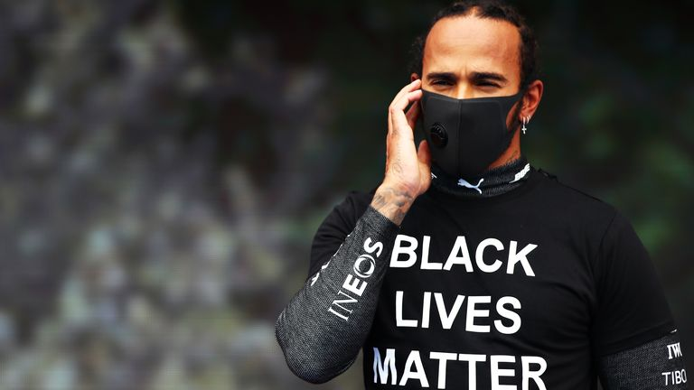 Lewis Hamilton of Great Britain and Mercedes GP is seen wearing a black lives matter t-shirt prior to the Formula One Grand Prix of Hungary at Hungaroring on July 19, 2020 in Budapest, Hungary. (