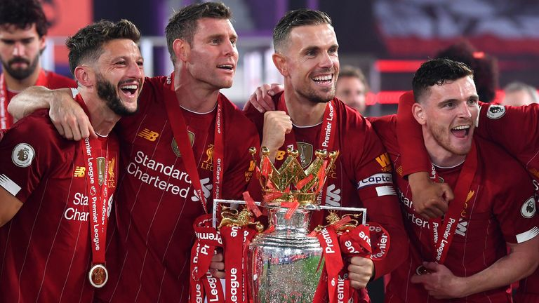 Liverpool celebrate with the Premier League trophy