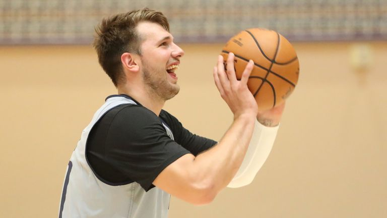 Luka Doncic launches a shot during the Dallas Mavericks' first practice inside the Orlando bubble