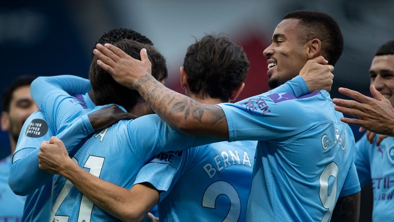 MANCHESTER, ENGLAND - JULY 15: Goalscorer David Silva of Manchester City is congratulated by team mates including Gabriel Jesus during the Premier League match between Manchester City and AFC Bournemouth  at Etihad Stadium on July 15, 2020 in Manchester, United Kingdom. (Photo by Visionhaus) *** Local Caption *** David Silva; Gabriel Jesus