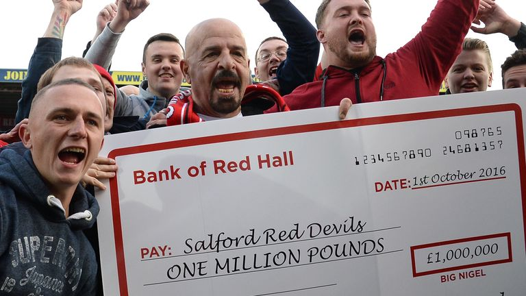 Marwan Koukash celebrates with the fans after Salford's victory