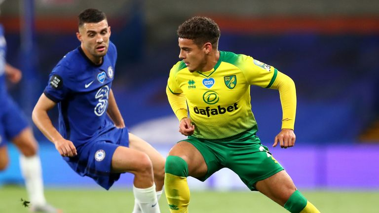 Mateo Kovacic of Chelsea (L) and Max Aarons of Norwich City compete for the ball during the Premier League match at Stamford Bridge