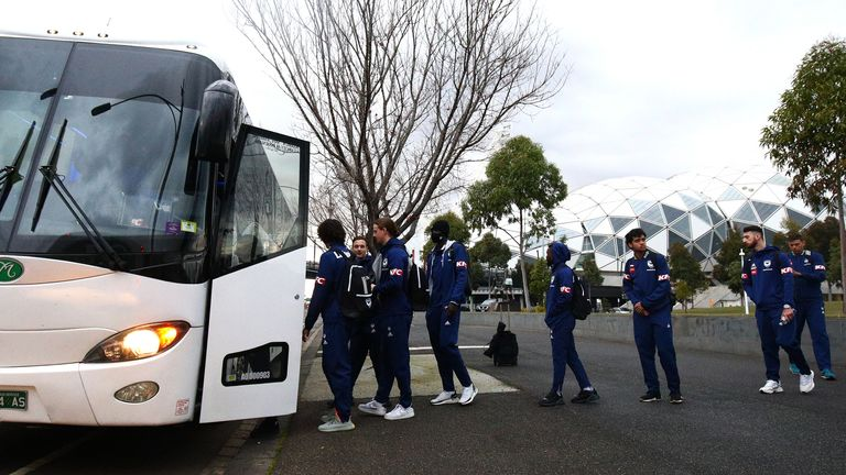 Melbourne Victory players board a bus as they head for a flight out of Victoria